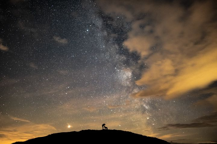 Ben, Floyd &amp; the Core, by Ben Bush.<br /><br />The image depicts the photographer and his dog, Floyd, surrounded by Mars, Saturn and the galactic core of the Milky Way galaxy. As his constant companions, the photographer often tries (and fails) to capture his dogs at night. With this shot the shutter speed was reduced to 10 seconds to allow to keep Floyd still &ndash; the photographer whispered &lsquo;don't move, don't move, don't move&rsquo; to Floyd for the whole 10 seconds.&nbsp;