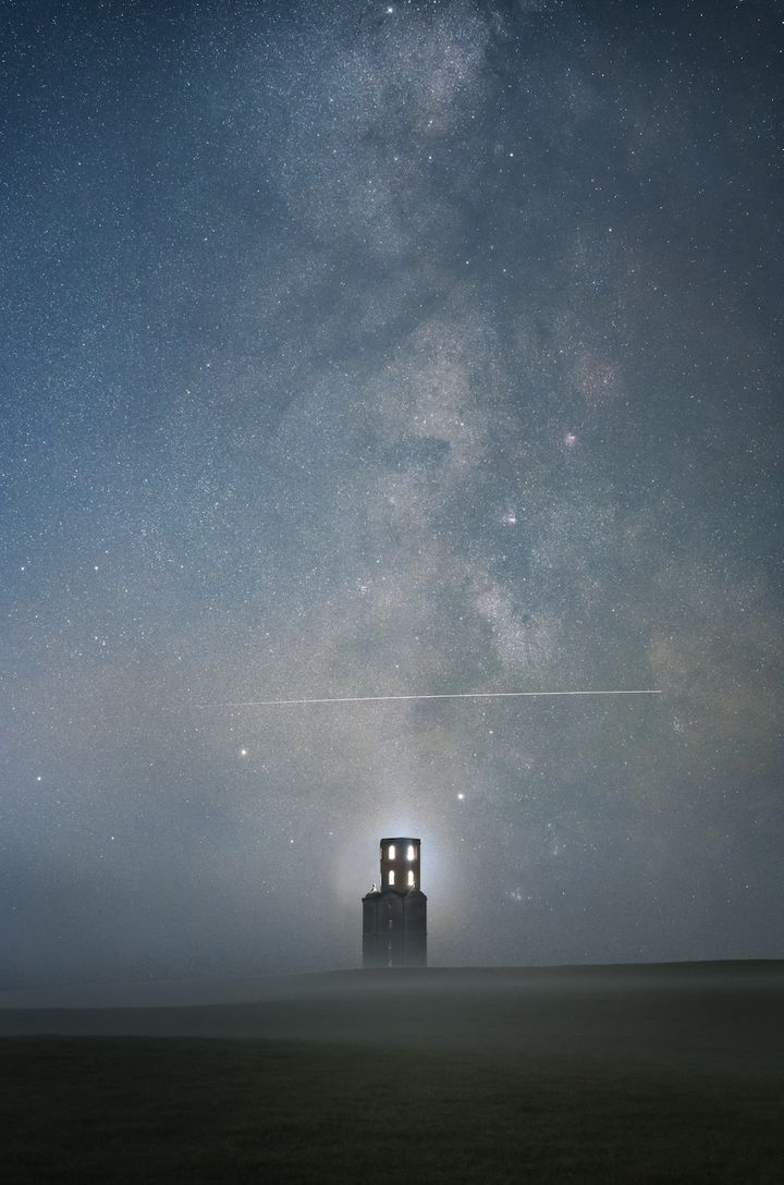 Above the Tower, Sam King.<br /><br />The International Space Station (ISS) is flying over Horton Tower in Dorset on a misty evening. The tower is believed to have been built with the intention of being used as an observatory. During the two exposures shot for the sky, the photographer was able to perfectly capture the ISS fly directly over the tower. Although the mist didn't help with capturing the finer details of the core, it did add mystery to the final image, as did the tower&rsquo;s lights.&nbsp;