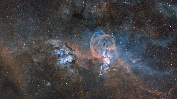 Statue of Liberty Nebula, by Ignacio Diaz Bobillo.<br /><br />These are two nebula complexes, far apart from one another. The one on the right, NGC 3576, is closer to Earth, and its shape provides the title of this image.&nbsp;