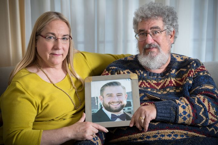 Mary and Joel Rich hold a photo of their son in their Omaha, Nebraska, home on Jan. 11, 2017. Seth Rich, a Democratic Nationa