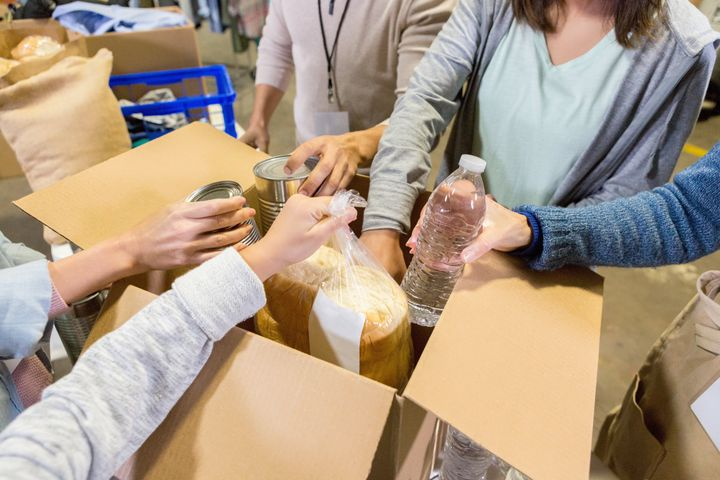 Food bank volunteers sort through donated food items.