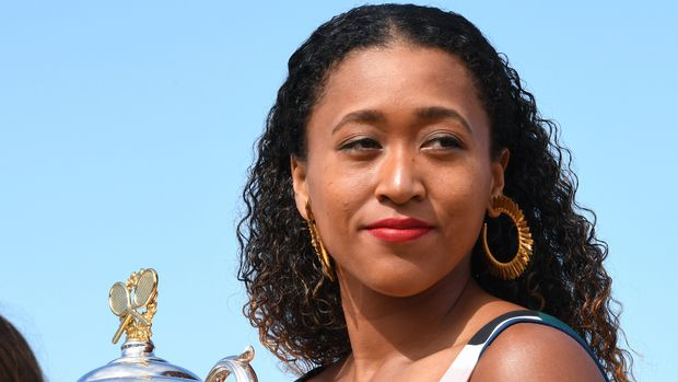 MELBOURNE, AUSTRALIA - JANUARY 27: Naomi Osaka of Japan poses with the Daphne Akhurst Memorial Cup during the Women's Australian Open media opportunity at Brighton Beach on January 27, 2019 in Melbourne, Australia. (Photo by James D. Morgan/Getty Images)