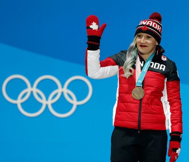 Bronze medallist Kaillie Humphries waves from the podium at thePyeongchang Winter Olympics on Feb....