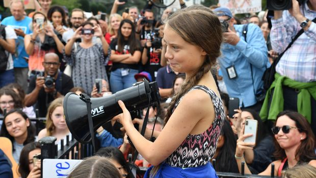 """TOPSHOT - Swedish environment activist Greta Thunberg speaks at a climate protest outside the White House in Washington, DC on September 13, 2019. - Thunberg, 16, has spurred teenagers and students around the world to strike from school every Friday under the rallying cry """"Fridays for future"""" to call on adults to act now to save the planet. (Photo by Nicholas Kamm / AFP)        (Photo credit should read NICHOLAS KAMM/AFP/Getty Images)"""