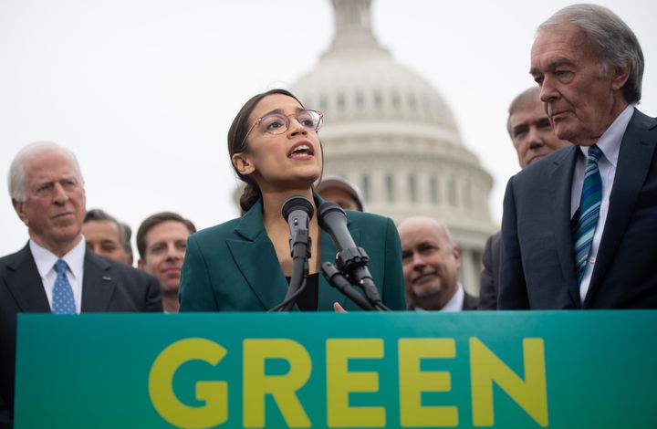 Rep. Alexandria Ocasio-Cortez (D-N.Y.) joins Sen. Ed Markey (D-Mass.), right, to announce Green New Deal legislation in Febru