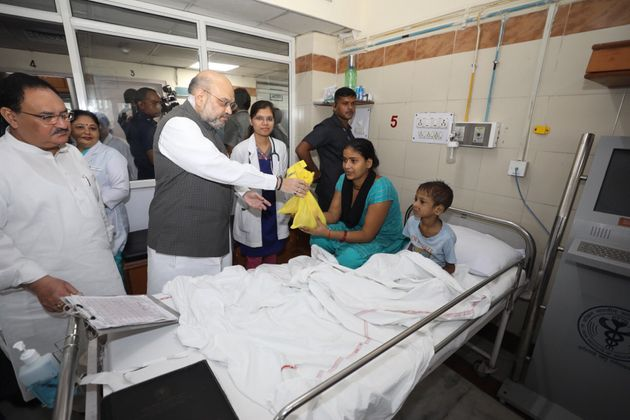Union Home Minister Amit Shah distributing sweets and fruits to AIIMS patients on Saturday