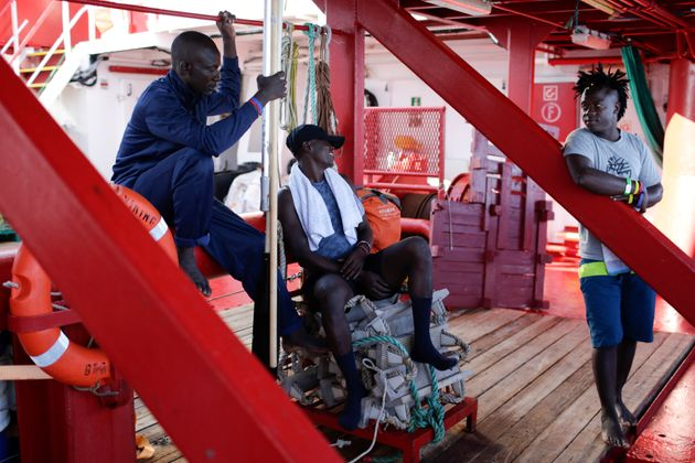 Migrants talk to each other aboard the Ocean Viking in the Mediterranean Sea, Saturday, Sept. 14, 2019....