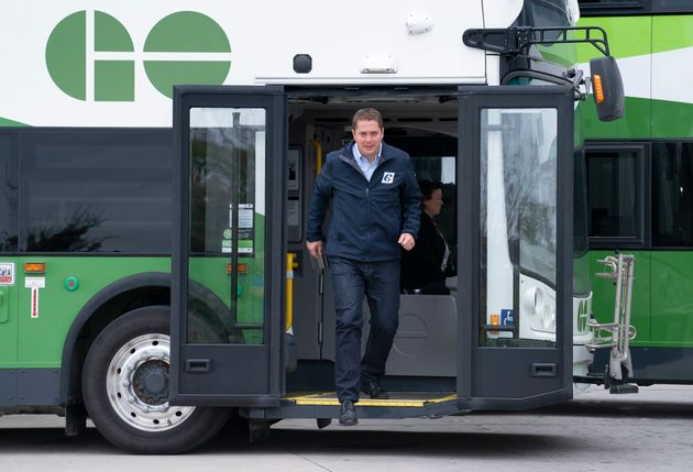 Conservative Leader Andrew Scheer steps off a public transit bus in Mississauga , Ont. on