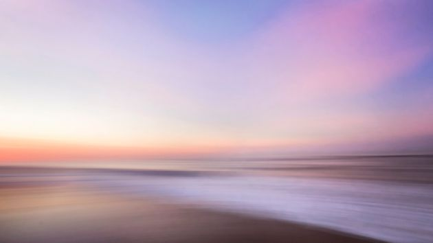 Beautiful soft colors with pinks and blues on a winter sunrise at Jones Beach, Long Island,