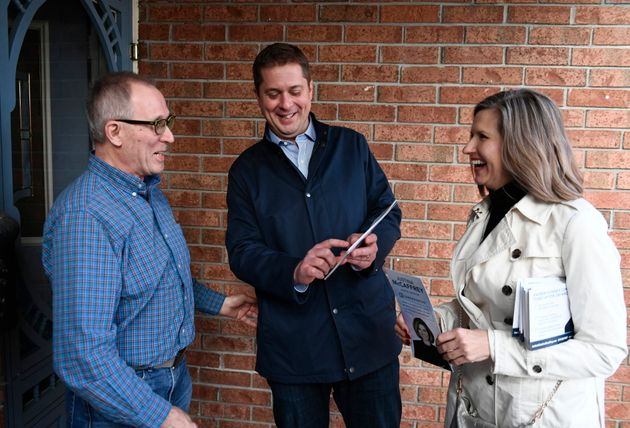 Conservative Leader Andrew Scheer speaks to a resident with Kanata Carleton candidate Justina McCaffrey,...