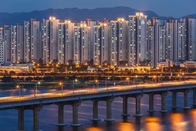 Skyline city with river and bridge at