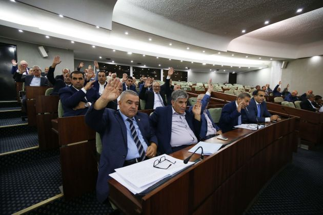 The deputies of the National People's Assembly vote for, the draft organic law amending and supplementing...