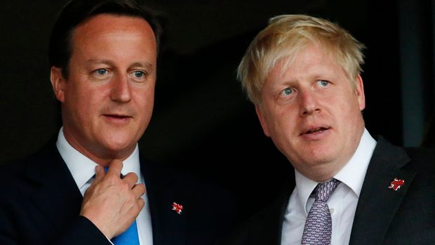 FILE - This is a Friday, July 27, 2012   file photo of Britain's Prime Minister David Cameron, left, and the then  Mayor of London  Boris Johnson as they wait for the start of the Opening Ceremony at the 2012 Summer Olympics, Friday, July 27, 2012, in London. Cameron announced Friday June 24 2016 that he plans to resign following the result of Britain's EU referendum. Cameron said he would stay on for as long as was necessary for stability's sake, but that he could not be the one to lead Britain out of Europe. (AP Photo/Jae C. Hong, File)