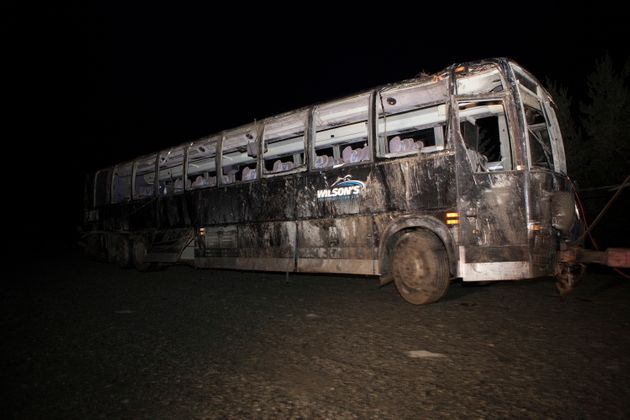 A passenger bus involved in an accident along a logging road Friday night is carried from the crash scene...