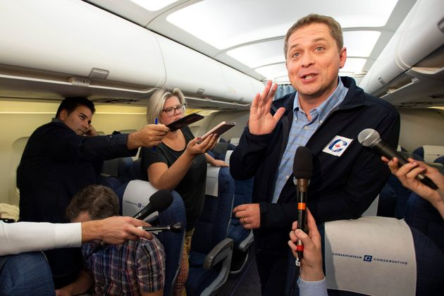 Conservative Leader Andrew Scheer scrums on a late night Federal Election flight from Ottawa to Vancouver...