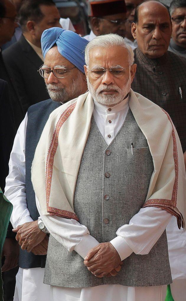 Prime Minister Narendra Modi, front, and former Prime Minister Manmohan Singh in a file