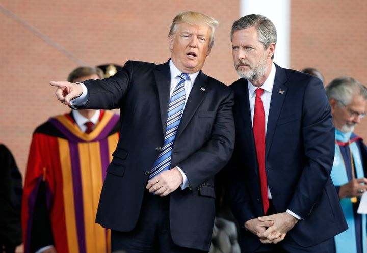 President Donald Trump speaks with Jerry Falwell Jr. during commencement ceremonies at Liberty University in Lynchburg, Virgi