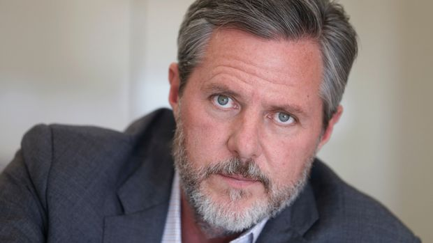 "FILE - In this Nov. 16, 2016, file photo, Liberty University president Jerry Falwell Jr., poses during an interview in his offices at the school in Lynchburg, Va. Falwell Jr. said Tuesday, Sept. 10, 2019, that he is asking the FBI to investigate what he called a ""criminal"" smear campaign orchestrated against him by several disgruntled former board members and employees. (AP Photo/Steve Helber, File)"