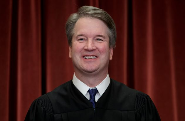 FILE - In this Nov. 30, 2018, file photo Associate Justice Brett Kavanaugh sits with fellow Supreme Court...