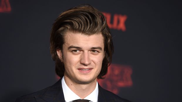 """Joe Keery arrives at the premiere of """"Stranger Things"""" season two at the Regency Bruin Theatre on Thursday, Oct. 26, 2017, in Los Angeles. (Photo by Jordan Strauss/Invision/AP)"""