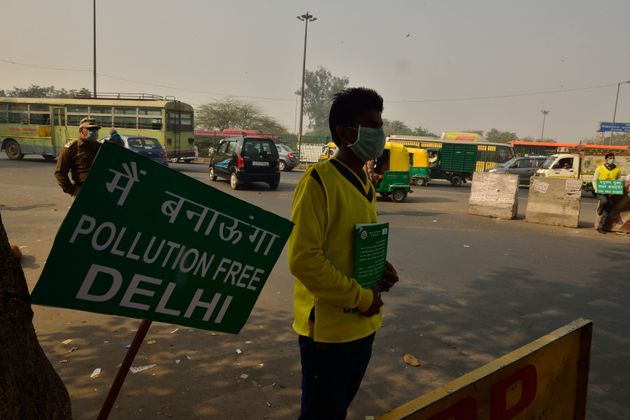 Volunteers implementing odd-even rule at New Delhi's Anand Vihar on January 5,