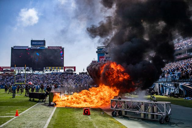 A pyrotechnic accident lights a part of the field on fire before an NFL football game between the Tennessee...