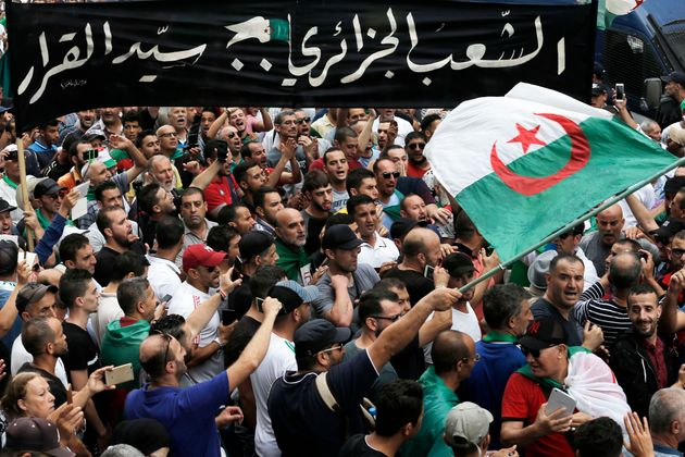 Algerian demonstrators take to the streets in the capital Algiers to protest against the government,...