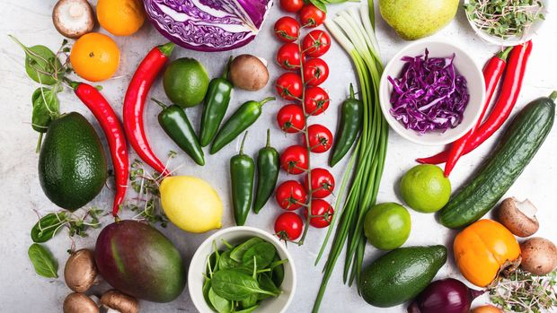 Selection of fresh  vegetables and fruits viewed from above, healthy plant based vegan food