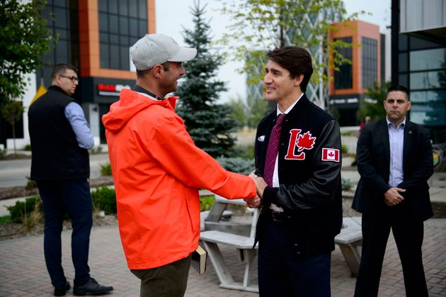 Liberal Leader Justin Trudeau talks to a voter in Kitchener, Ont., on Sept. 16,