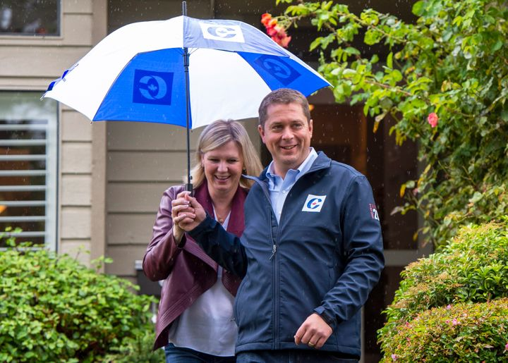 Conservative Leader Andrew Scheer and his wife Jill leave a campaign announcement in Surrey, B.C., Sept. 15, 2019.
