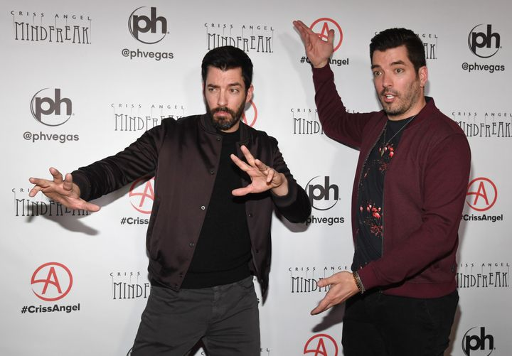 "Property Brothers Drew Scott, left, and Jonathan Scott, right, strike a magician-esque pose at the grand opening of ""Criss Angel: Mindfreak"" on Jan. 19, 2019 in Las Vegas."