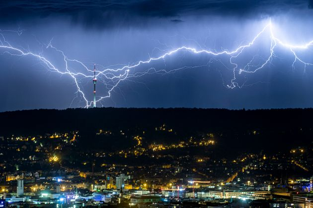 Lightning appears over Stuttgart, Germany, in July 2019 as the heatwave in large parts of Europe gives...