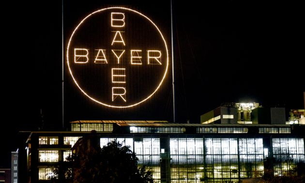 The Bayer logo shines at night at the main chemical plant of German Bayer AG on Thursday, Aug. 9, 2019...