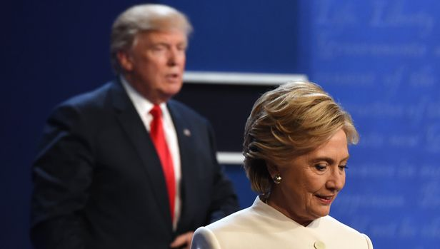 TOPSHOT - Democratic nominee Hillary Clinton (R) and Republican nominee Donald Trump walk off the stage after the final presidential debate at the Thomas & Mack Center on the campus of the University of Las Vegas in Las Vegas, Nevada on October 19, 2016. (Photo by Robyn Beck / AFP)        (Photo credit should read ROBYN BECK/AFP/Getty Images)