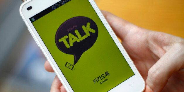 In this Aug. 20, 2012 photo, a woman opens Kakao Talk, a South Korean mobile messaging app with more...