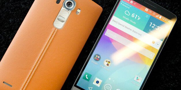 The leather-covered LG G4, left, is displayed next to an LG G3, Tuesday, April 28, 2015 in New York....