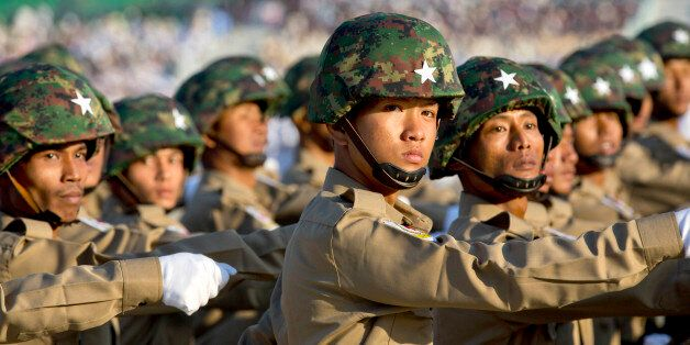 In this Jan. 4, 2015, file photo, Burmese military officers march in a parade during a ceremony for Myanmar's...
