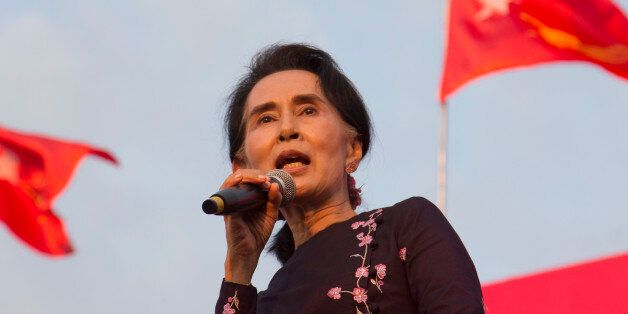 Myanmar opposition leader Aung San Suu Kyi speaks during an election campaign rally of her National League...