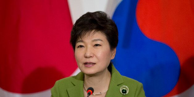 South Korean President Park Geun-hye speaks during a trilateral meeting with President Barack Obama and...