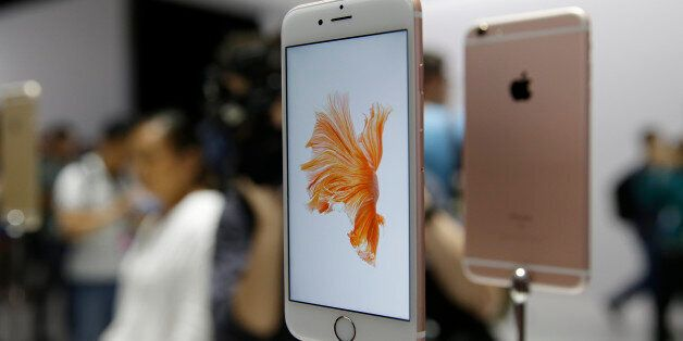 People look over the new Apple iPhone 6s models during a product display following an Apple event Wednesday,...