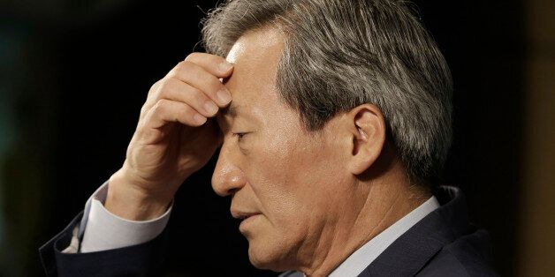 South Korean FIFA presidential candidate Chung Mong-joon pauses to answer questions during a news conference...