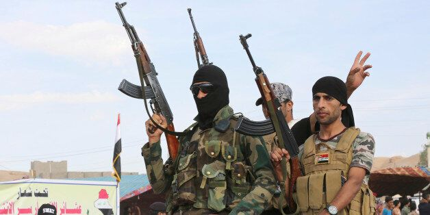 Sunni volunteer fighters parade as they prepare to support Iraqi security forces in liberating the city...