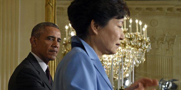 President Barack Obama listens as South Korean President Park Geun-hye speaks during their joint news...