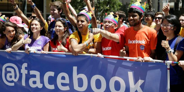 Facebook employees and family members march during the 44th annual San Francisco Gay Pride parade Sunday,...
