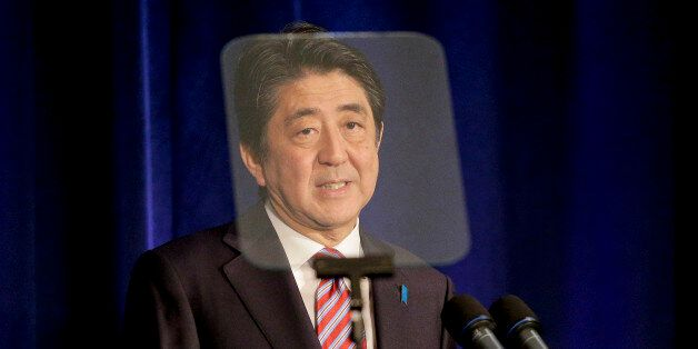 Japan Prime Minister Shinzo Abe speaks during a news conference, Tuesday, Sept. 29, 2015, in New York....