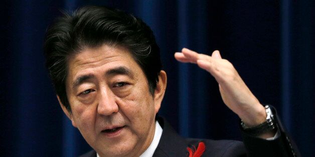 Japan's Prime Minister Shinzo Abe speaks about the agreement on the Trans-Pacific Partnership trade deal...