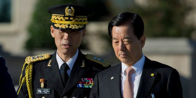 South Korean Defense Minister Han Min-koo, right, arrives at the Pentagon for the full military honors...