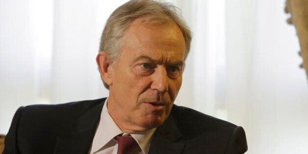 International Mideast envoy and former British prime minister Tony Blair talks with Egyptian Foreign...