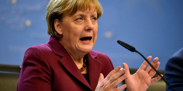German Chancellor Angela Merkel talks to the media at a press conference after the EU summit in Brussels,...