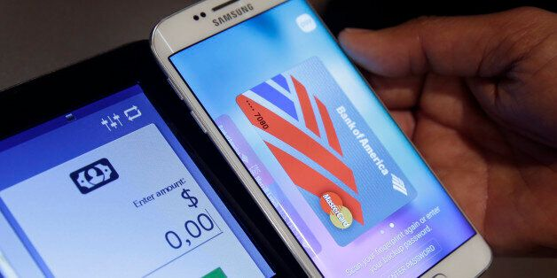 In this Aug. 6. 2015, photo, a Samsung employee demonstrates Samsung Pay using a Galaxy S6 Edge Plus...